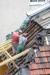 Two men installing a roof in Orlando.